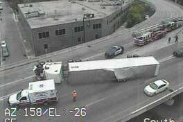 Police are responding to an overturned 18-wheeler at Finesilver Curve, an exit ramp from Interstate 35 to Interstate 10, near downtown.
