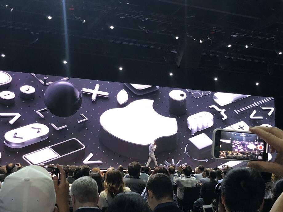 Apple CEOTim Cook on the stage at Apple's developers conference. Photo: Wendy Lee