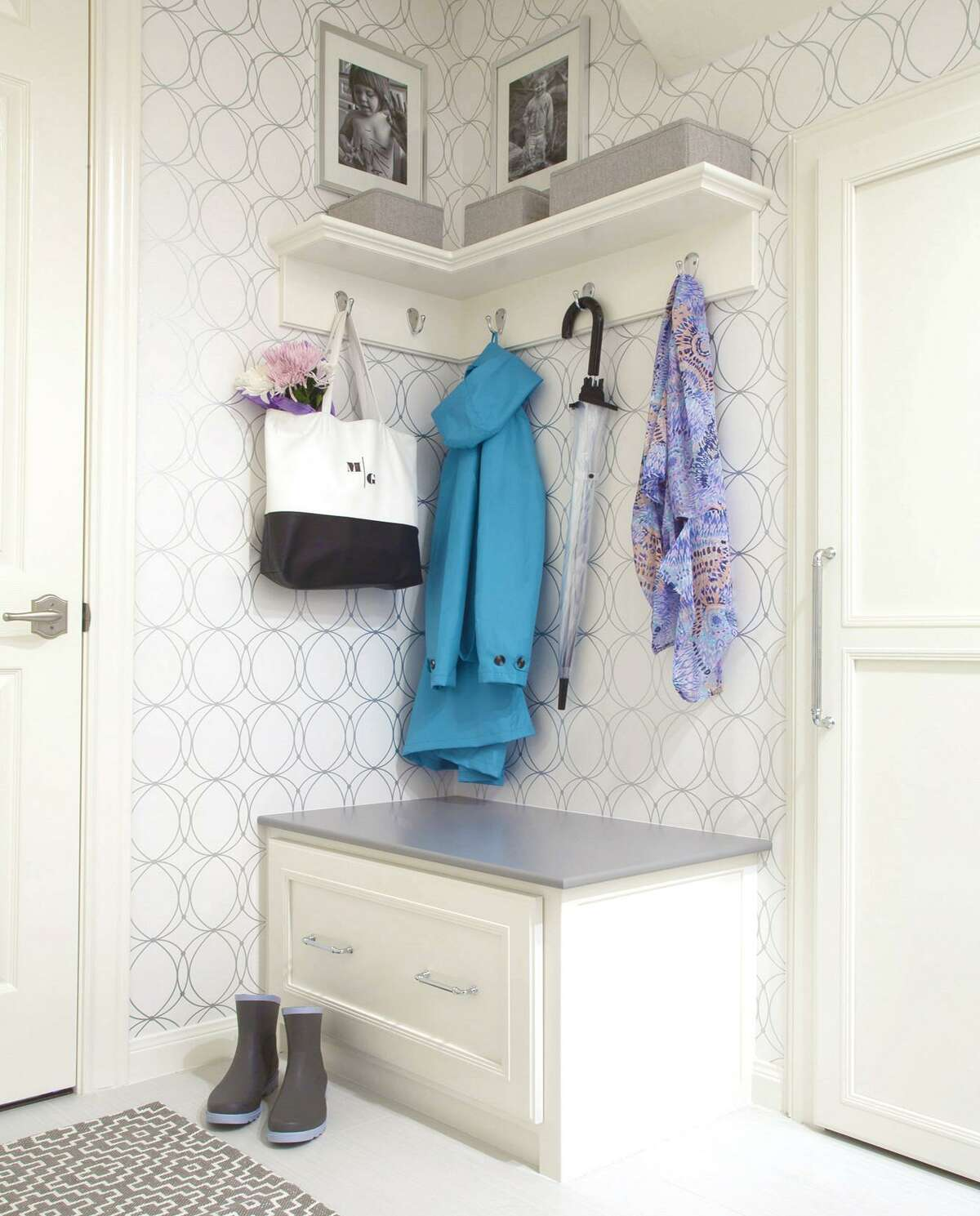 Karen Davis's new mud room has a storage bench where her kids can sit to put shoes on and hooks for hanging jackets, bags and backpacks.