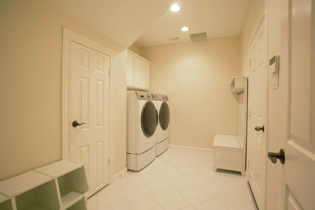 Before its makeover, Karen Davis's mud room was bland, with not enough storage and shoe cubbies and a small bench that didn't really suite her family's needs.