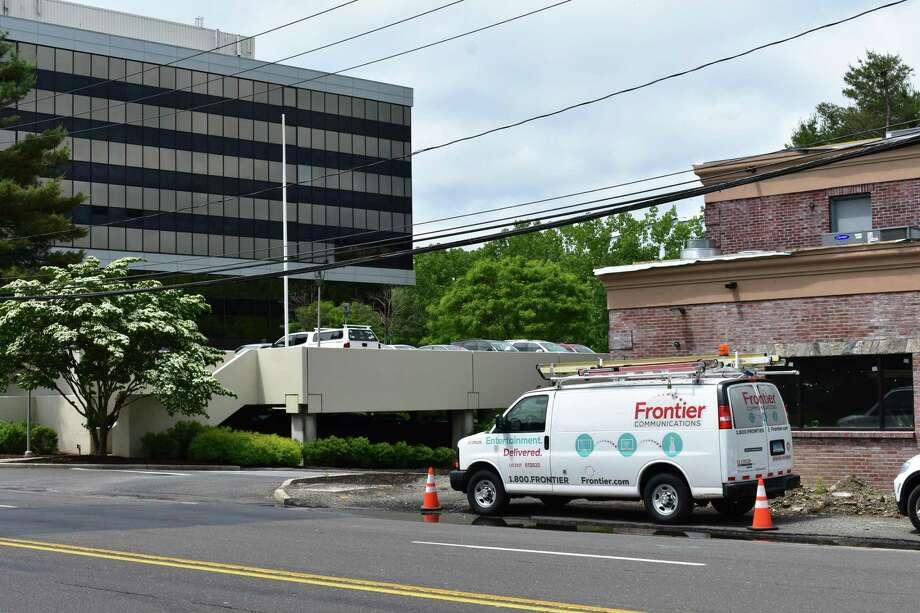 "A Frontier Communications van adjacent to the Merritt 7 Corporate Park in Norwalk, Conn., where Frontier has its corporate headquarters. Frontier reported a $517 million loss in 2017 on its Connecticut operations, largely the result of a write-down in the ""goodwill"" inherent in the assets it acquired from AT&T in October 2014. Photo: Alexander Soule / Hearst Connecticut Media / Stamford Advocate"