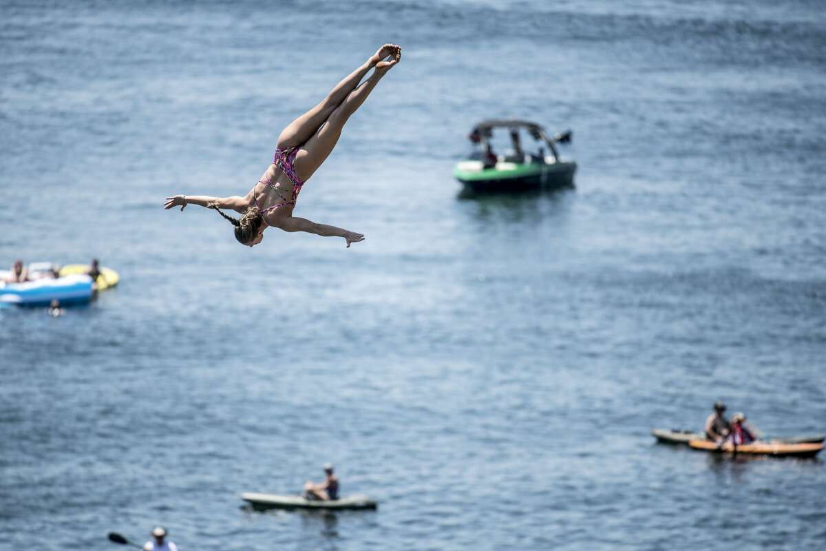 Jessica Macaulay of the UK dives from the 21 meter platform during the first competition day of the first stop at the Red Bull Cliff Diving World Series on June 1, 2018 at Possum Kingdom Lake, Texas.