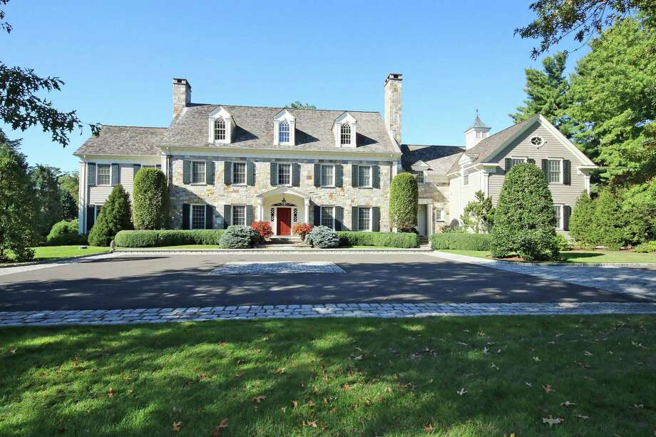 The custom-built 12-room colonial at 1481 Hillside Road sits on a nearly three-acre property with an in-ground swimming gpool and tennis court.