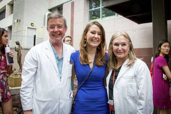 Rebecca Thompson with her parents, Gretchen Zimmerman, M.D., and David Thompson, M.D.,