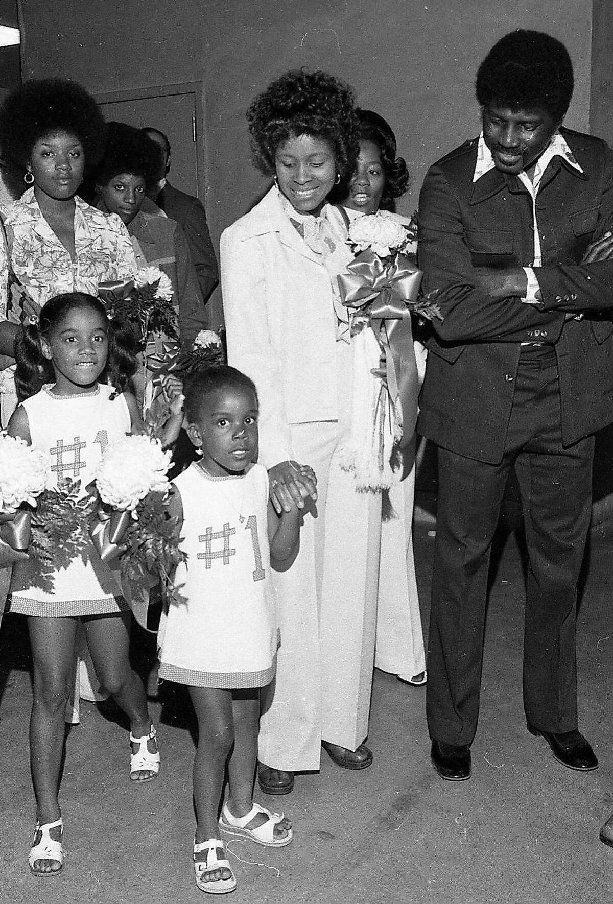 At the Golden State Warriors Awards ceremony at the Oakland Coliseum, after winning the NBA Championship, Ericka Attles and Jodty Roberts, daughter of assistant coach Joe Roberts where white dresses with blue #1, May 29, 1975