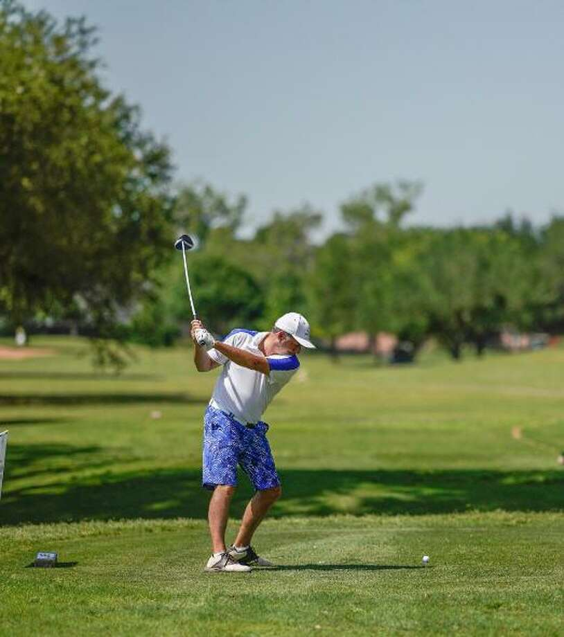 Golfer John Rodgers tees off at the 2018 Katy Christian Ministries Golf Tournament. Photo: Amazing Images Photography / Amazing Images Photography
