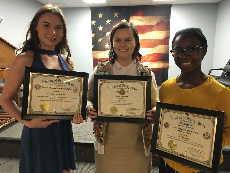 Katy Veterans of Foreign Wars Post 9182 recognized three Katy-area youths for their accomplishments at its May 17 grand reopening of its post. From left are Emily Schweizerhof, Voice of Democracy award winner; Angela Lytle, Scout of the Year; and Nia Adeogun, Patriot Pen award winner. Photo: Karen Zurawski / Karen Zurawski