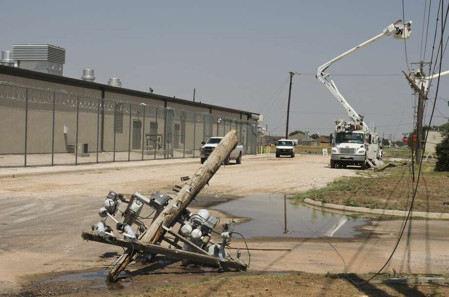 Utility crews work to restore powerlines and broken poles 06/04/18 afternoon outside the Midland County Jail after two poles broke during storms Sunday night, leaving the jail to run on generators since 9 p.m. Sunday night. Tim Fischer/Reporter-Telegram Photo: Tim Fischer/Midland Reporter-Telegram