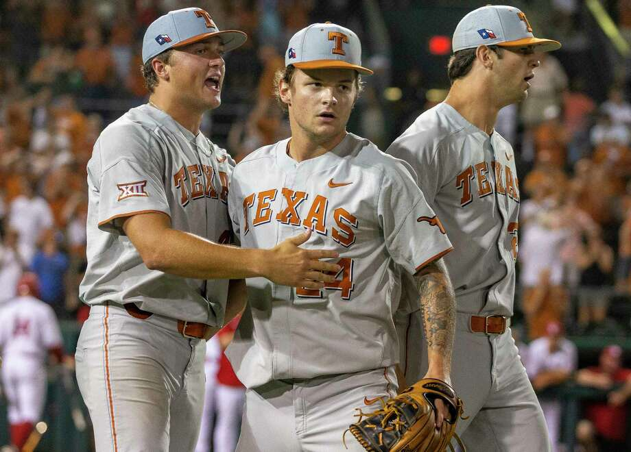 Texas closer Chase Shugart, (24) celebrates a 3-2 win over Indiana with Andy McGuire and Blair Henley during an NCAA regional game at UFCU Disch-Falk Field in Austin, Texas, Sunday, June 3, 2018. Photo: Stephen Spillman / stephenspillman@me.com Stephen Spillman