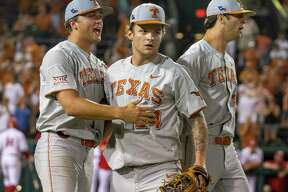 Texas closer Chase Shugart, (24) celebrates a 3-2 win over Indiana with Andy McGuire and Blair Henley during an NCAA regional game at UFCU Disch-Falk Field in Austin, Texas, Sunday, June 3, 2018.