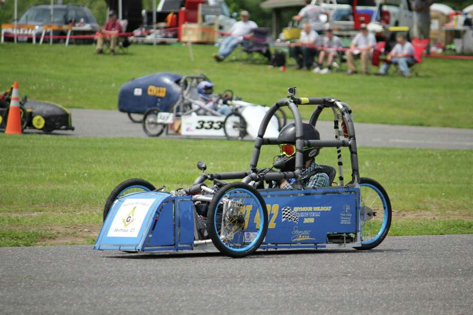 Students in Seymour High School's metal shop recently raced to a third-place finish in a statewide electric car race at Lime Rock Park. Photo: Contributed Photo
