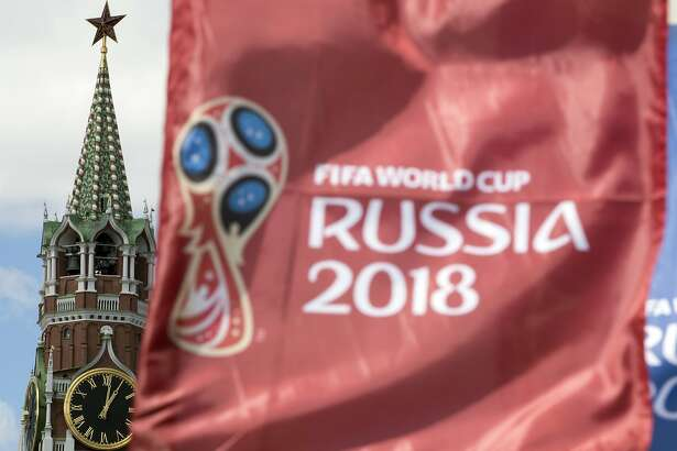 A flag with the logo of the World Cup 2018 flutters in the wind, with the Spasskaya Tower in the background, in Moscow, Russia, Friday, June 1, 2018. (AP Photo/Pavel Golovkin)