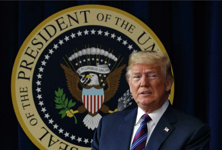 """President Donald Trump arrives for a bill signing ceremony on May 30 in the South Court Auditorium on the White House campus. The president says he has """"absolute right to PARDON myself"""" but says he has """"done nothing wrong"""" in the Russia probe. Photo: Evan Vucci, STF / Associated Press / Copyright 2018 The Associated Press. All rights reserved."""