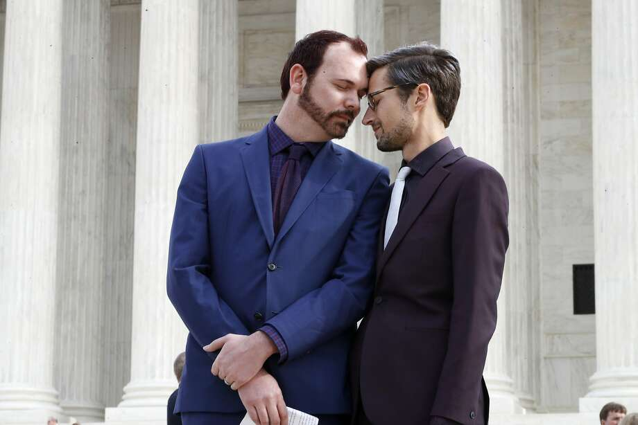 In this Dec. 5, 2017 file photo, Charlie Craig, left, and David Mullins touch foreheads after leaving the Supreme Court in Washington. The Supreme Court is setting aside a Colorado court ruling against a baker who wouldn't make a wedding cake for a same-sex couple. But the court is not deciding the big issue in the case, whether a business can refuse to serve gay and lesbian people.  (AP Photo/Jacquelyn Martin) Photo: Jacquelyn Martin, Associated Press