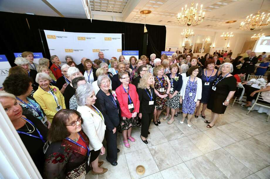 Honorees at the Connecticut League for Nursing's Leaving a Nursing Legacy, 65 Over 65 Nurse Recognition event, line up for a photograph at the Aqua Turf Club in Plantsville Friday. Photo: Arnold Gold / Hearst Connecticut Media / New Haven Register