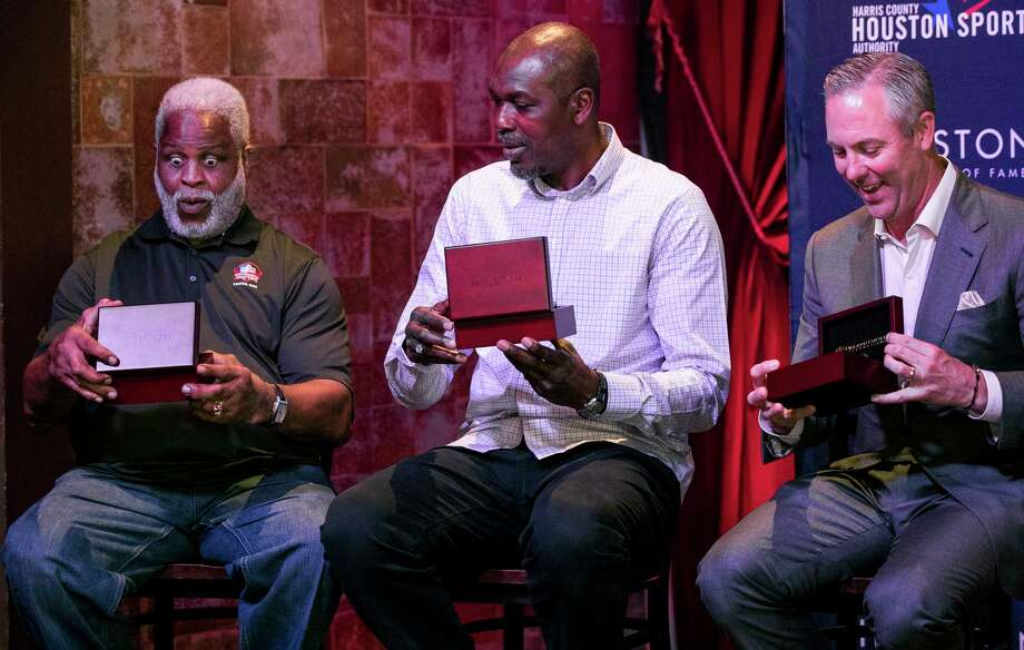 Earl Campbell's reaction (left) was arguably the most memorable moment of the ring ceremony for the inaugural Houston Sports Hall of Fame class. He was joined by Rockets legend Hakeem Olajuwon and Astros great Nolan Ryan, who was represented by his son Reid. Photo: Brett Coomer, Houston Chronicle / © 2018 Houston Chronicle