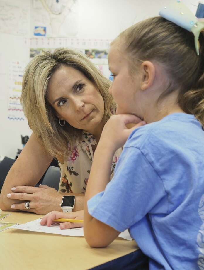 Fasken Elementary kindergarten teacher Dana Terebessy works with a student 05/29/18. Tim Fischer/Reporter-Telegram Photo: Tim Fischer/Midland Reporter-Telegram