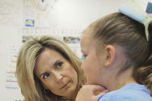 Fasken Elementary kindergarten teacher Dana Terebessy works with a student 05/29/18. Tim Fischer/Reporter-Telegram