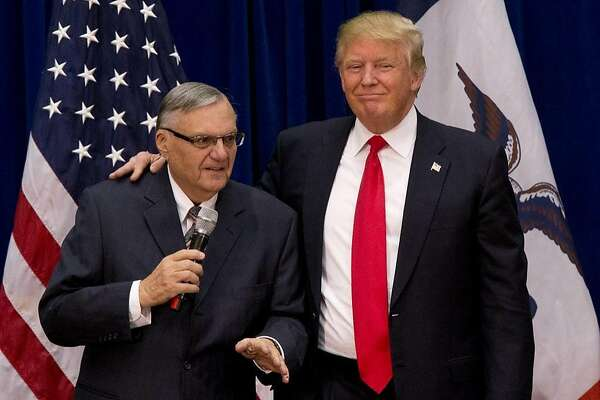 Republican presidential candidate Donald Trump is joined by Maricopa County, Ariz., Sheriff Joe Arpaio campaign event at the Roundhouse Gymnasium, Tuesday, Jan. 26, 2016, in Marshalltown, Iowa. (AP Photo/Mary Altaffer)