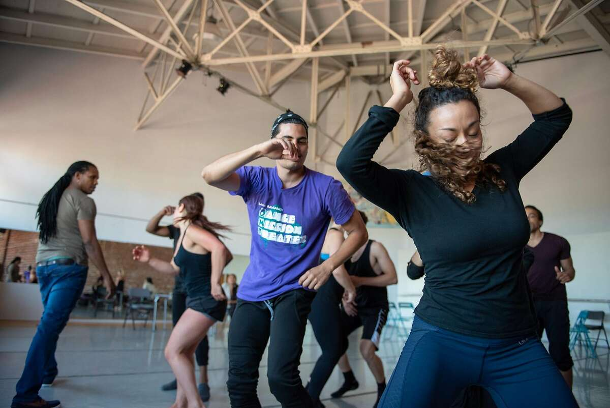Dancers Adonis Martin Qui�ones (center wearing purple shirt) and Jillian Miller (right) dance a rumba with other members of the Alayo Dance Company, as artistic director Ramon Ramos Alayo looks on, during a rehearsal for the upcoming Cuba Caribe Festival, in San Francisco on Friday, June 1, 2018.