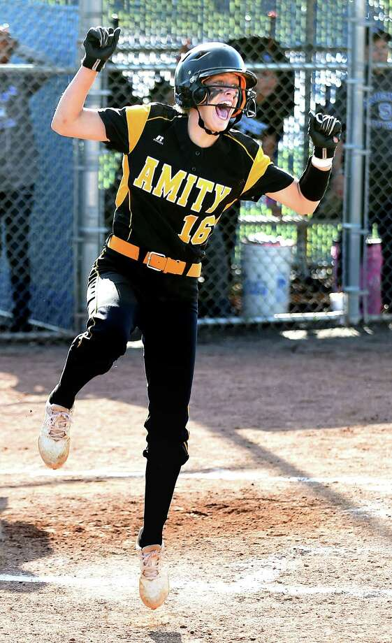 Nicole Koshes celebrates after scoring what would be the winning run in a 6-5 come from behind win over Southington in the Class LL softball semifinals in West Haven on June 4, 2018. Photo: Arnold Gold, Hearst Connecticut Media / New Haven Register