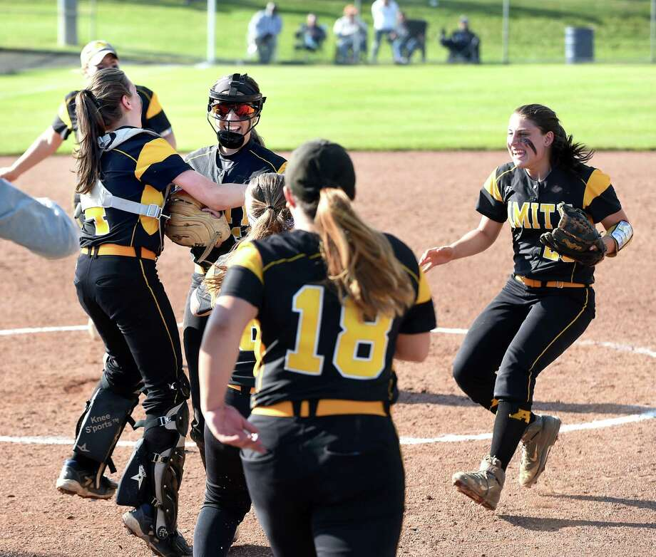 Amity players mob Kelly Pritchard (center) after the last out in a come from behind 6-5 win over Southington in the Class LL softball semifinals in West Haven on June 4, 2018. Photo: Arnold Gold, Hearst Connecticut Media / New Haven Register