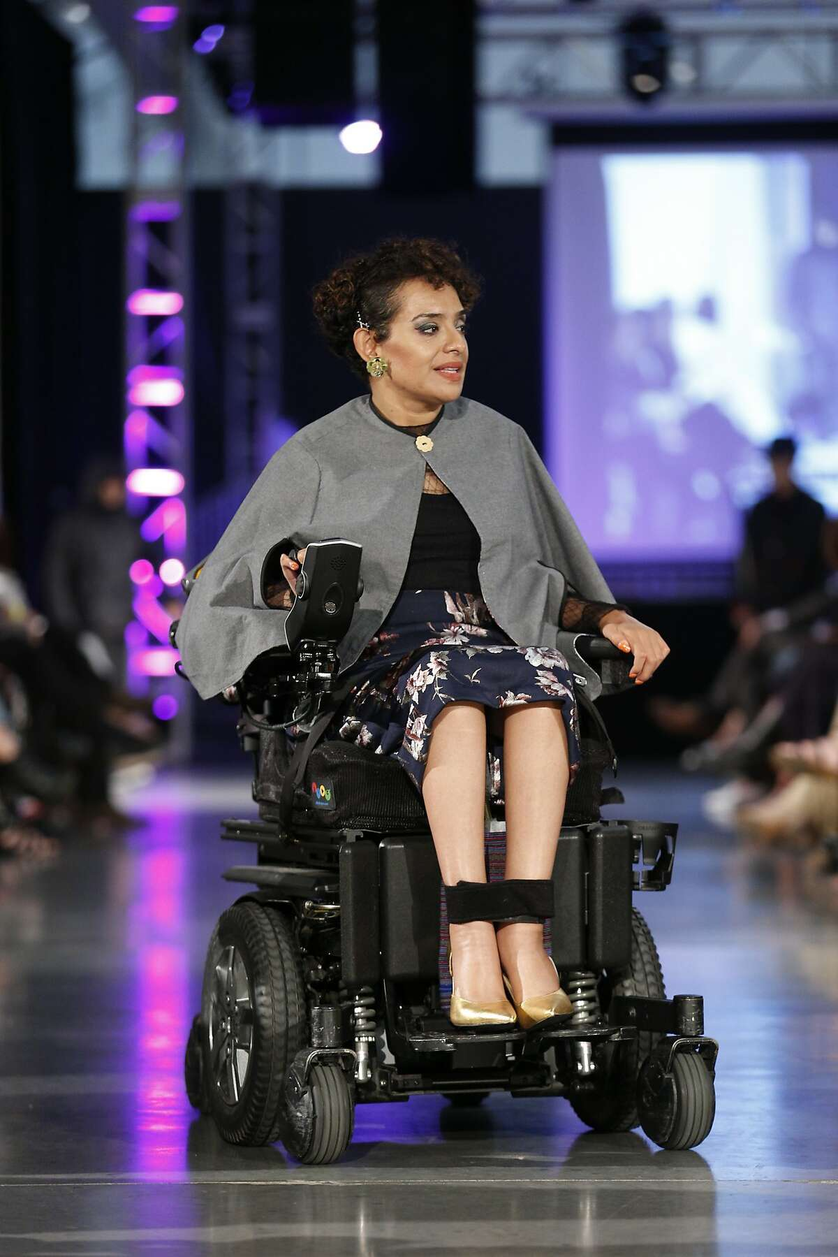 Ligia Andrade Zuniga worked with two S.F. State students, who designed her work-appropriate poncho, lace stretch top and floral pencil skirt.