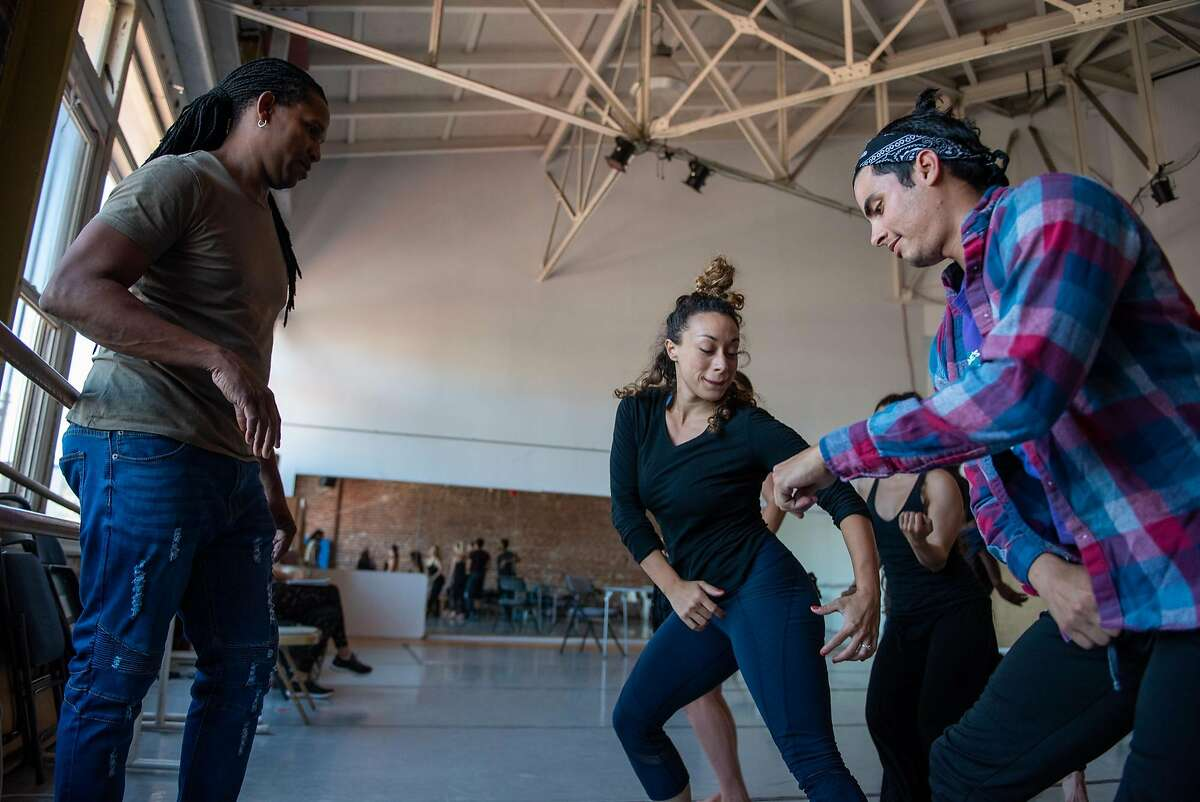 Artistic director Ramon Ramos Alayo (left) choreographs a rumba with dancers Jillian Miller (center), Adonis Martin Qui�ones (right) and other members of the Alayo Dance Company in preparation for the Cuba Caribe Festival, in San Francisco on Friday, June 1, 2018.