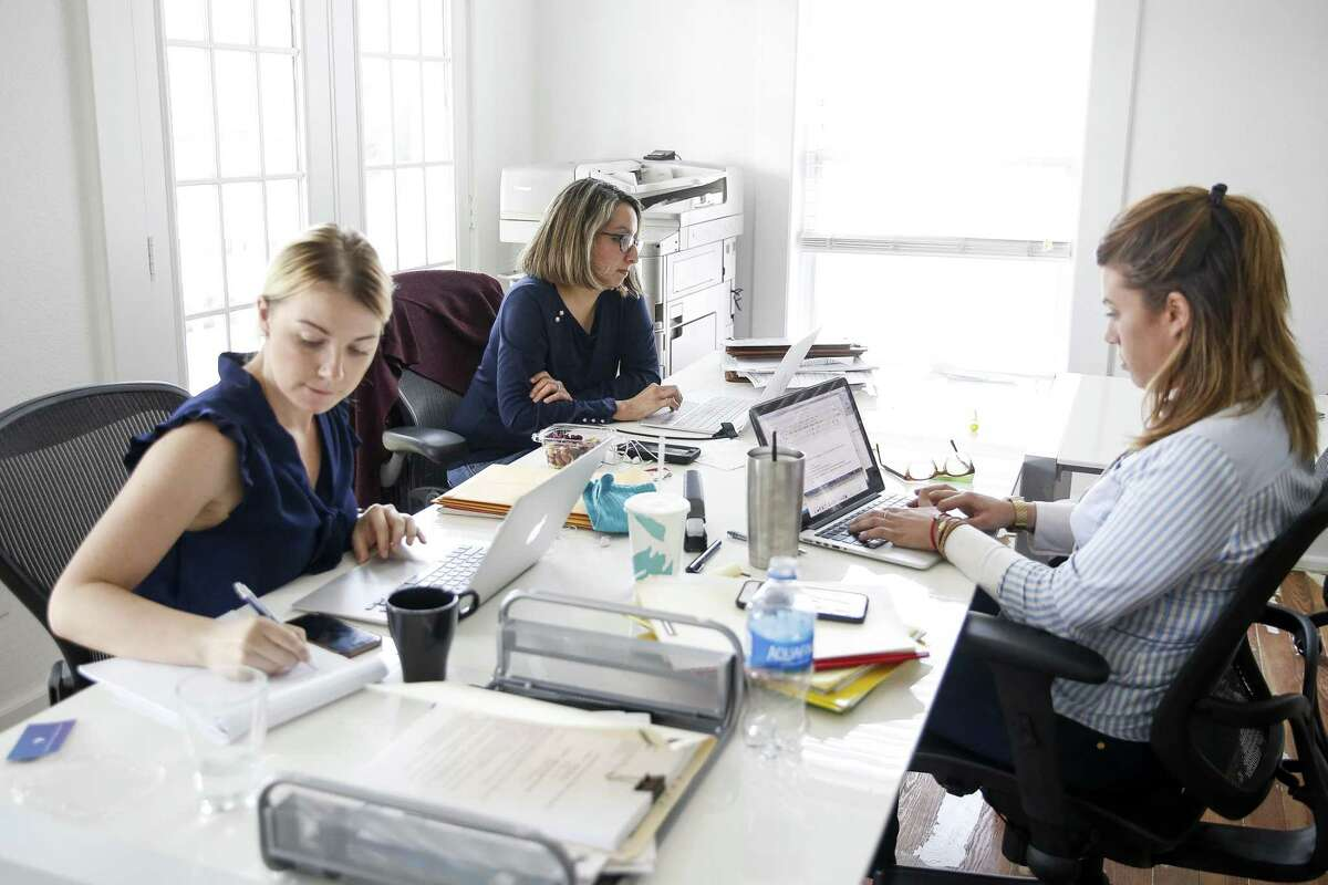 McGettrick Law owner and PassRight chief legal officer Denise McGettrick, center, works in her office Friday, June 1, 2018 in Houston. McGettrick has partnered with a San Francisco startup to create a website that streamlines the application process for employment based visas. (Michael Ciaglo / Houston Chronicle)