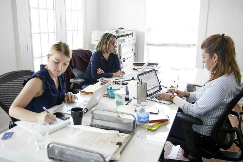 McGettrick Law owner and PassRight chief legal officer Denise McGettrick, center, works in her office Friday, June 1, 2018 in Houston. McGettrick has partnered with a San Francisco startup to create a website that streamlines the application process for employment based visas. (Michael Ciaglo / Houston Chronicle) Photo: Michael Ciaglo, Houston Chronicle / Houston Chronicle / Michael Ciaglo