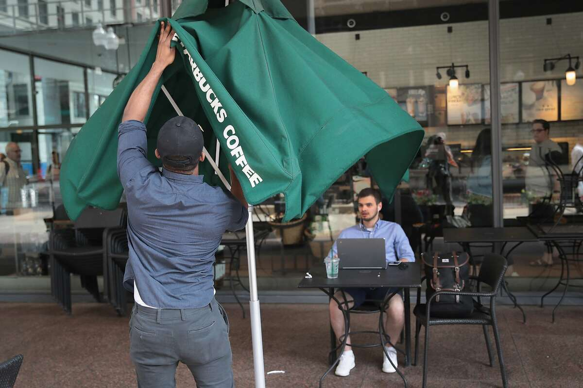 A worker shuts down the patio of a Starbucks store on May 29, 2018 in Chicago, Illinois. In reaction to a highly-publicized incident in which two black businessmen were arrested inside a Philadelphia Starbucks store, the company closed about 8000 company-owned stores this afternoon to hold racial-bias education programs for its nearly 175,000 employees.