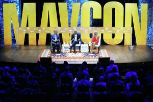 Texas Gov. Greg Abbott, left, and Arkansas Gov. Asa Hutchinson, center, speak to the Maverick PAC during its annual meeting at the Moody Theater in Austin, Texas on Saturday, June 2, 2018. Jackie Rooney, right, moderated the discussion. MavPAC was founded by a group of young political fundraising bundlers in Texas in 2004 and more than 200 hundred members from over a dozen states are expected to attend.