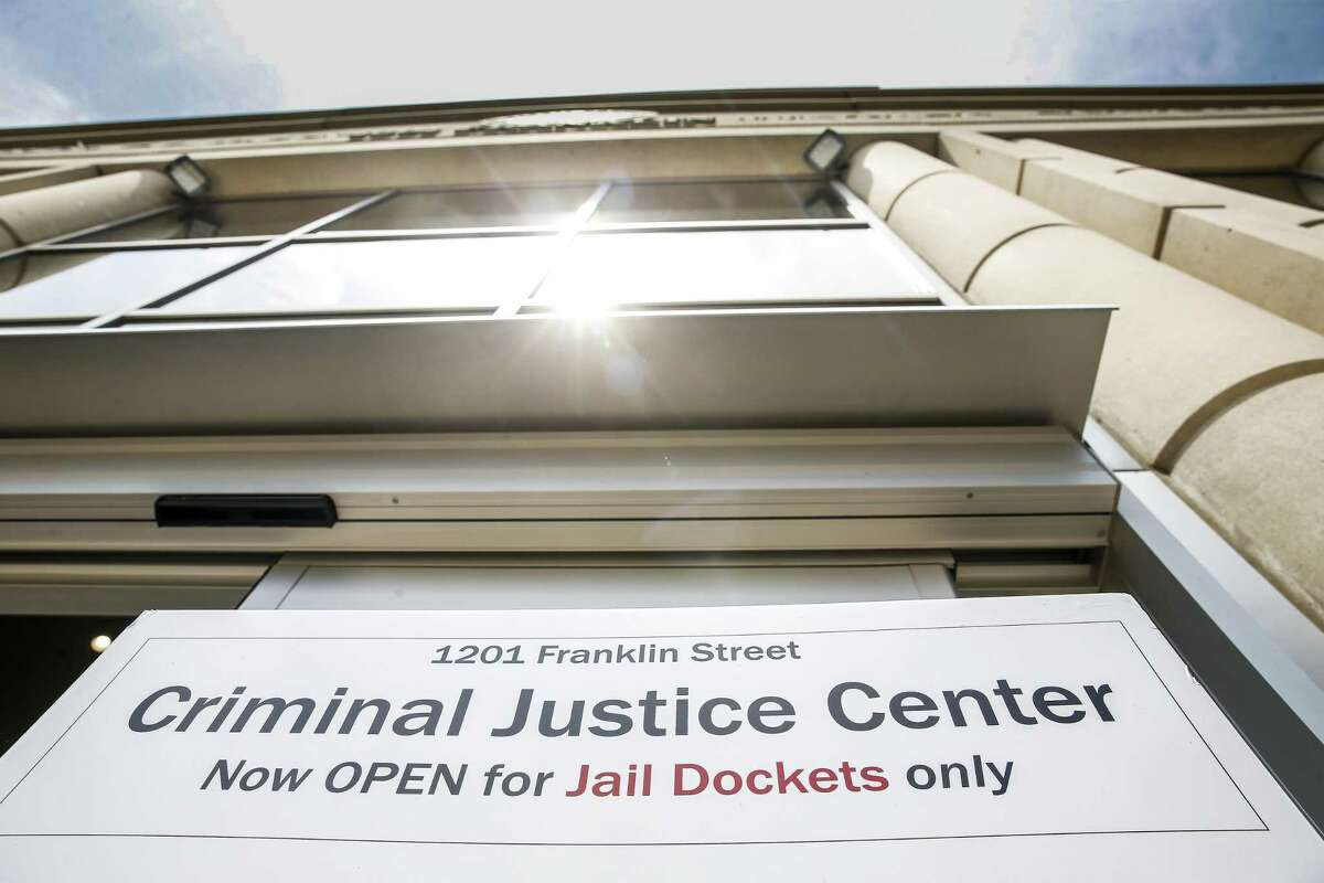 A sign sits outside the Harris County Criminal Justice Center Monday, June 4, 2018 in Houston. The courthouse, which had been closed since Hurricane Harvey, reopened for the first time on Monday. (Michael Ciaglo / Houston Chronicle)