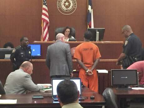 A defendant appears before a Harris County judge in Houston.