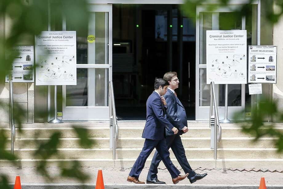 People walk past the Harris County Criminal Justice Center Monday, June 4, 2018 in Houston. The courthouse, which had been closed since Hurricane Harvey, reopened for the first time on Monday. (Michael Ciaglo / Houston Chronicle) Photo: Michael Ciaglo, Houston Chronicle / Houston Chronicle / Michael Ciaglo