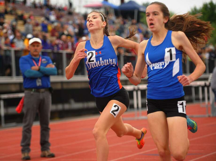 Danbury's Lauren Moore, left, takes second place in a photo finish to Rocky Hill's Elizabeth Stockman in the girls 1600 meters at the CIAC Track & Field Championships in New Britain, Conn. on Monday, June 4, 2018. Photo: Brian A. Pounds / Hearst Connecticut Media / Connecticut Post