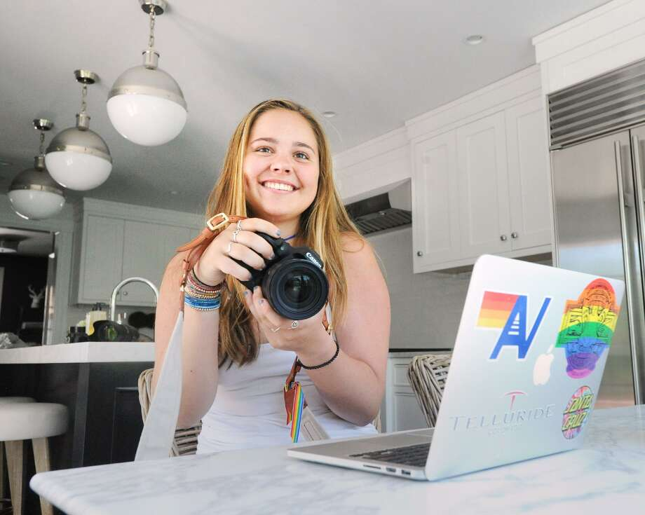 Greenwich High School senior Lucy Massam, 17, with her computer and camera at her home in Greenwich, Conn., Thursday, May 24, 2018. Massam has been busy with a YouTube vlog and also with offering her expertise on helping other students cope with stress and pressure. Photo: Bob Luckey Jr. / Hearst Connecticut Media / Greenwich Time