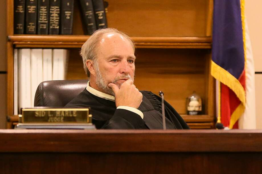 The retirement of Judge Sid Harle, left, in the 226th District Court means a race for an open seat. We recommend Republican Todd McCray. Photo: Marvin Pfeiffer /Staff Photographer / Express-News 2018