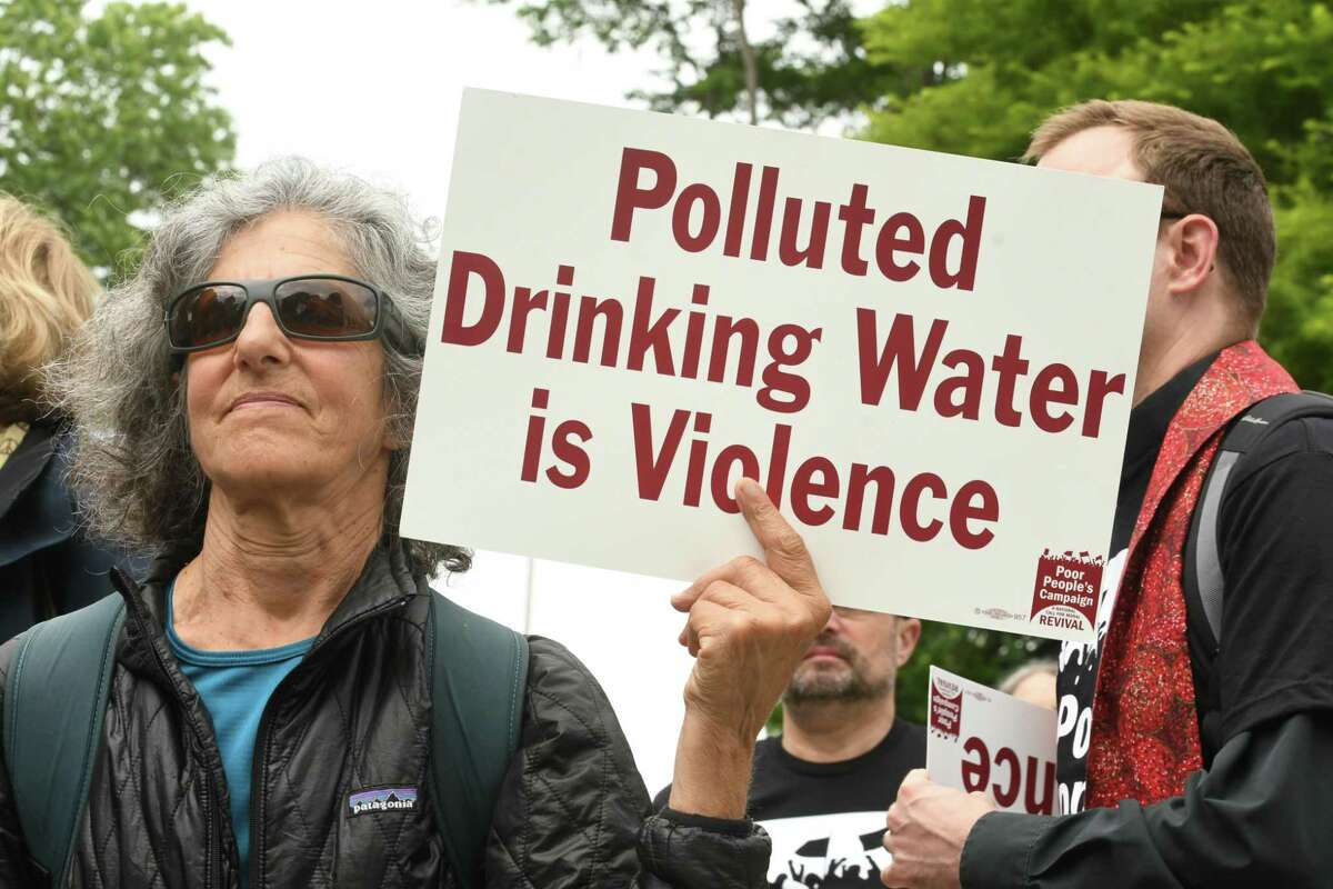 Dr. Susan Soboroff of Ithaca holds a sign as participants in New York Poor PeopleOs Campaign: A National Call for Moral Revival demand immediate action to ensure all New Yorkers have access to healthcare and clean drinking water on Monday, June 4, 2018 in Albany, N.Y. The protest took place in Layfayette Park near the Capitol. (Lori Van Buren/Times Union)