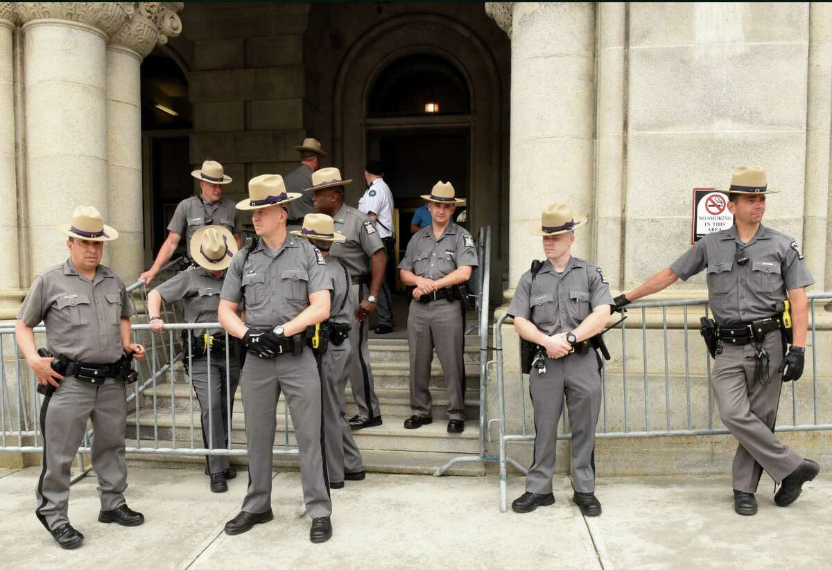 New York State Troopers wait outside the Capitol for expected protestors on Monday, June 4, 2018 in Albany, N.Y. Participants in New York Poor PeopleOs Campaign: A National Call for Moral Revival were demanding immediate action to ensure all New Yorkers have access to healthcare and clean drinking water in a protest across the street at Layfayette Park. (Lori Van Buren/Times Union)