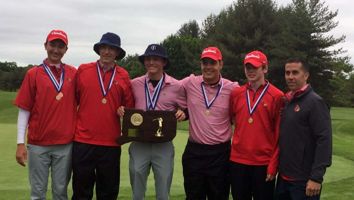The Greenwich High School boys golf team and coach Jeff Santilli, right, smile after winning the CIAC Division I championship at Stanley Golf Course in New Britain, Conn. on Monday, June 4, 2018.