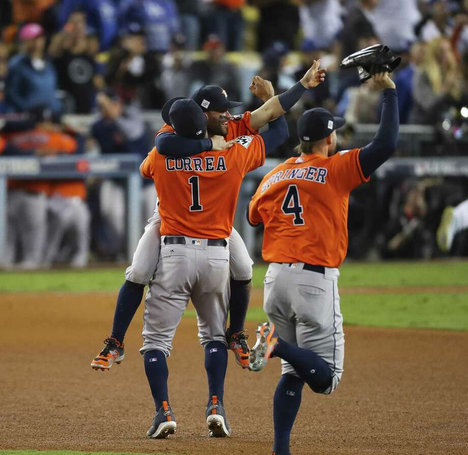 Houston Astros center fielder George Springer (4), second baseman Jose Altuve (27) and shortstop Carlos Correa (1) celebrate as the Astros beat the Dodgers 5-1 in Game 7 of the World Series at Dodger Stadium on Wednesday, Nov. 1, 2017, in Los Angeles. ( Michael Ciaglo / Houston Chronicle ) Photo: Michael Ciaglo, Houston Chronicle / Houston Chronicle / © 2017 Houston Chronicle