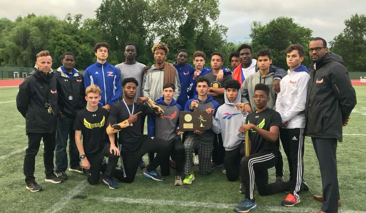 Danbury's boys track and field team poses with its 2018 State Open Championship Trophy at Willowbrook Park in New Britain Monday, June 4, 2018.