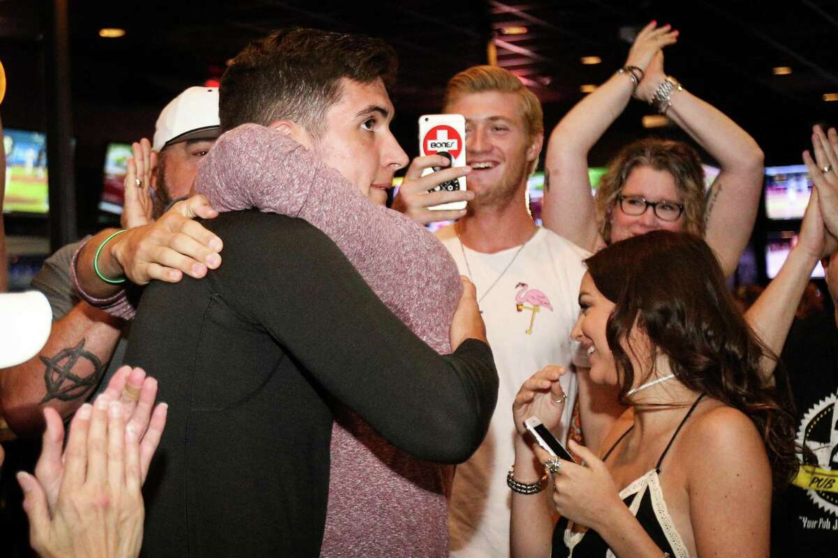 Magnolia's Jordan Groshans hugs his brother Jaxx after being drafted by the Toronto Blue Jays on Monday, June 4, 2018, at 242 Bar and Grill in Spring. (Michael Minasi / Houston Chronicle)
