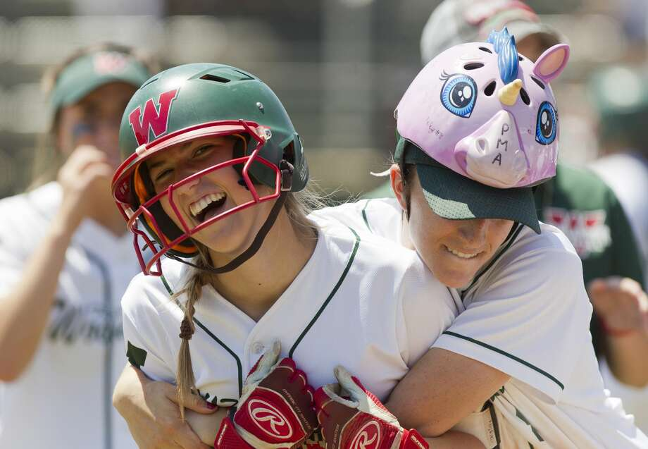The Wooodlands' Alayis Seneca, right, hugs Skylar Stockton after her 2-run home run during the second inning of a Region II-6A bi-district playoff series, Saturday, April 28, 2018, in The Woodlands. Photo: Jason Fochtman/Houston Chronicle