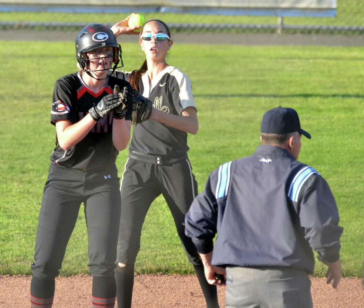 Cheshire's Mia Juodiatis claps after reaching second against Trumbull in Monday's Class LL semifinal.