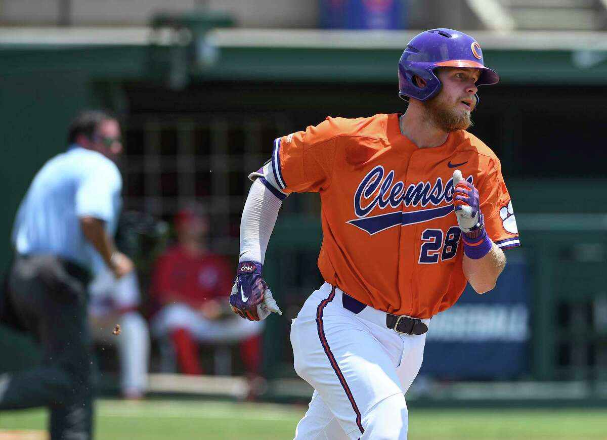 Clemson first baseman Seth Beer (28) rounds the bases after hitting a home run during an NCAA college baseball regional game against St. John's, Sunday, June 3, 2018, in Clemson, S.C. (Bart Boatwright/The Greenville News via AP)