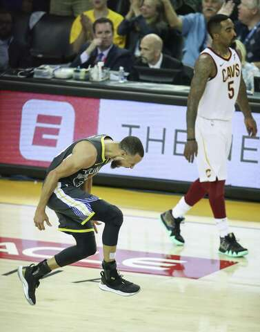 ba18a6a49 Golden State Warriors  Stephen Curry reacts after hitting a three-pointer  over Cleveland Cavaliers