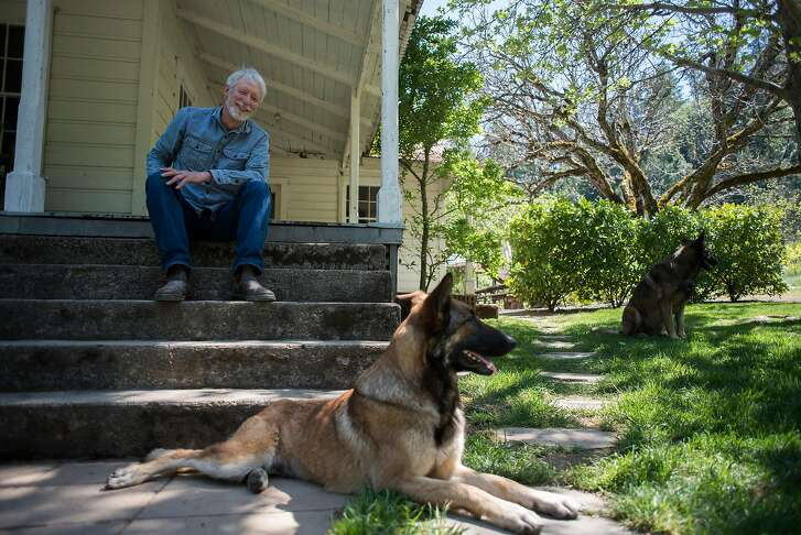 Richard Carter with his dogs at his home in Pope Valley, CA on April 25, 2018