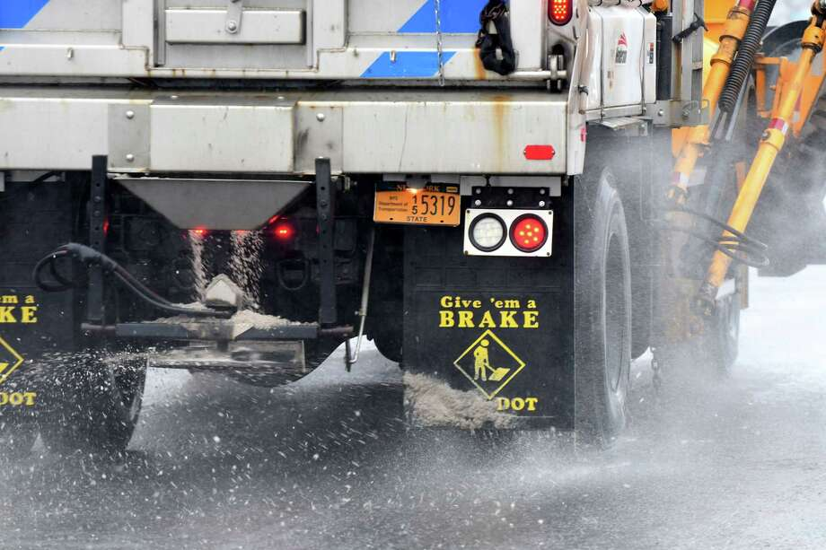 State DOT crews salt the roads on Columbia Turnpike near East Greenbush Town Hall on Tuesday, Feb. 7, 2017, in East Greenbush, N.Y. (Will Waldron/Times Union) Photo: Will Waldron / 20039633A